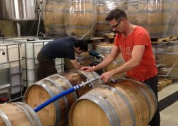 Vancouver Brewery Tours Inc. - Filling Barrels at Strange Fellows Brewing